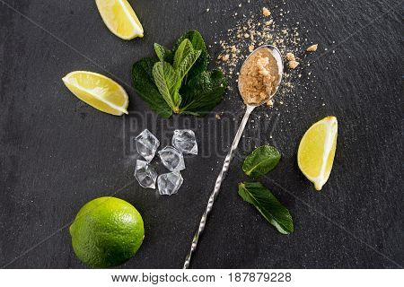 Lime Slices With Mint Leaves And Mix Spoon On Stone Board, Barman Cocktail