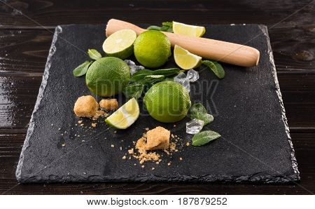 Lime Slices With Brown Sugar And Wooden Squeezer On Stone Board, Barman Cocktail