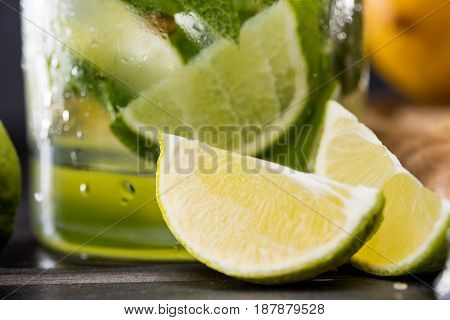 Close Up View Of Mojito Cocktail In Glass And Lime Slices, Barman Cocktail Concept