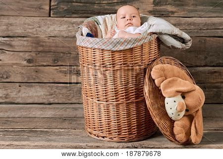 Basket with a baby. Cute caucasian child.