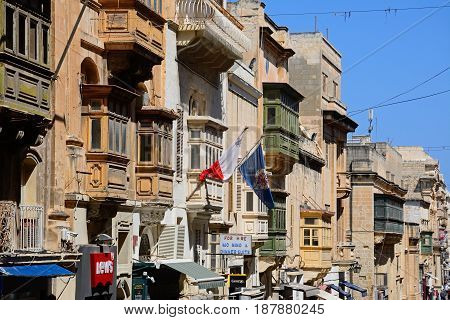VALLETTA, MALTA - MARCH 30, 2017 - Elaborate buildings and shops along Republic Street aka Triq Ir Repubblika Valletta Malta Europe, March 30, 2017.