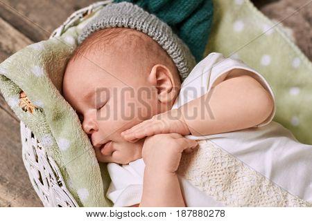 Adorable sleeping baby. Infant lying on towel.