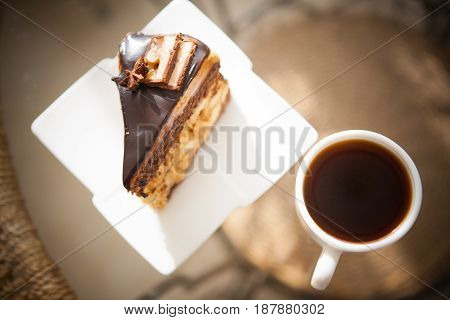 piece of sweet brownie with chocolate and coffee