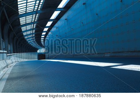 The empty road surface floor in tunnel inside