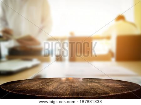 Selected focus empty brown wooden table and coffee shop cafe or business man blur background image. for your photomontage or product display