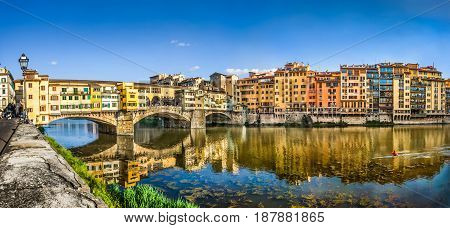 Panoramic View Of Famous Ponte Vecchio With River Arno At Sunset In Florence, Tuscany, Italy