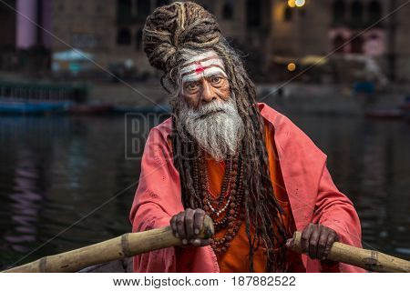 Portrait of sadhu rowing the boat, Varanasi, India.