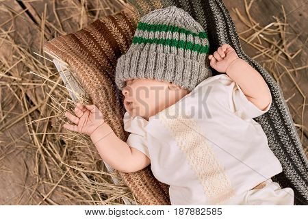 Cute baby, scarf and hat. Little kid top view.