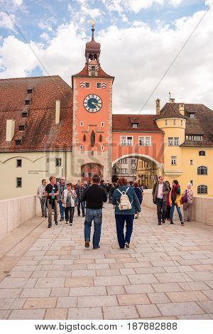 Regensburg,Germany-May 20,2017:People walk on The Stone Bridge (Steinerne Brücke) in Regensburg Germany a 12th-century bridge across the Danube linking the Old Town with Stadtamhof