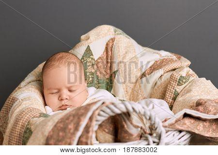 Caucasian child sleeping. Baby and blanket. Sleep calculator for kids.