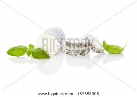 Goat cheese with basil isolated on white background. Culinary cheese eating.