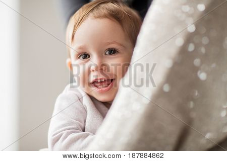 family, childhood and people concept - happy smiling little baby girl with mother