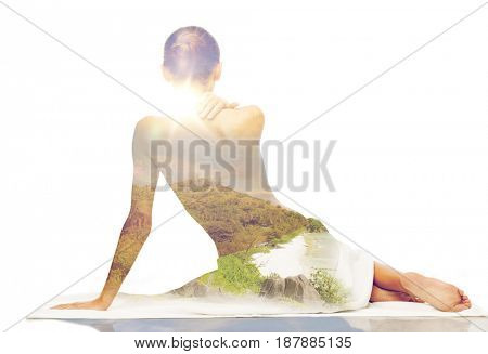 beauty, spa, people and bodycare concept - beautiful young woman in white towel with bare top over natural background double exposure effect