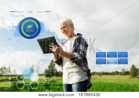 organic farming, agriculture, technology, old age and people concept - happy senior woman with tablet pc computer at county or farm