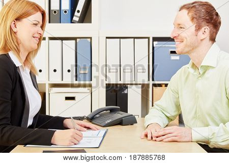 Applicant in a job interview with a woman in her office