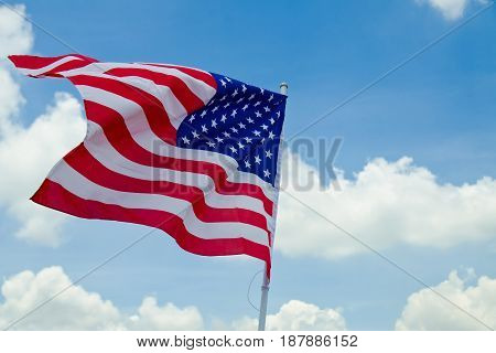 United States flag.have blue sky background.United States flag.have blue sky background.