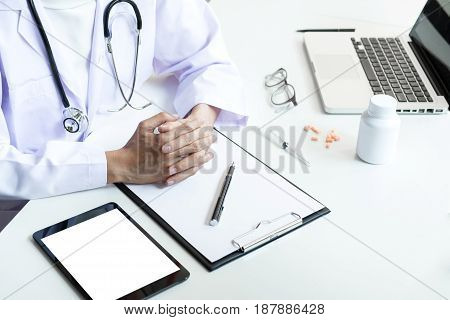 Health care and Medical concept Female doctor hand hold on clipboard pad to recommend treat of patient.