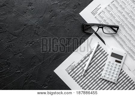 accounting work space with calculator, profit and tables on dark desk background top view mock-up