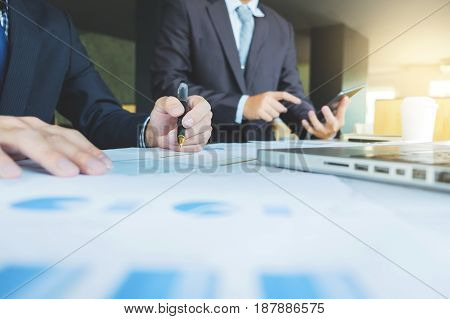 Business man discussing with financial analyst business development strategy project and using modern digital tablet with chart on a screen man meeting Selective focus.