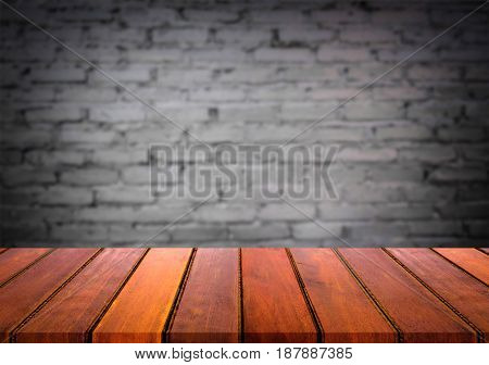 Selected focus empty brown wooden table and wall texture or old black brick wall blur background image. for your photomontage or product display