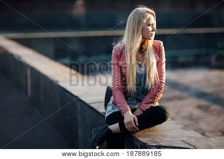 Beautiful Blond Woman Sitting Alone In The Street On Sunset