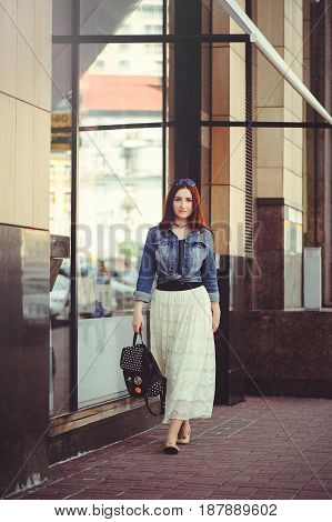 Young Woman Is Walking Around The City
