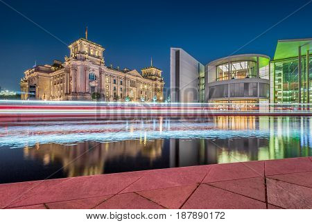 Berlin government district with Reichstag and Spree river at night