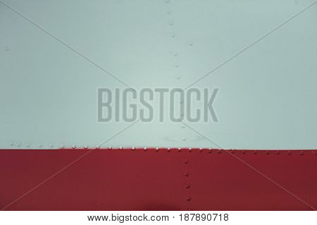 Light Blue And Cherry-colored Metal Plate With Rivets