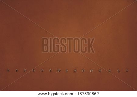 Brown Metal Plate With Rivets For Grunge Or Abstract Background.