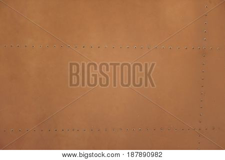 Light Brown Metal Plate With Rivets For Grunge Or Abstract Background.