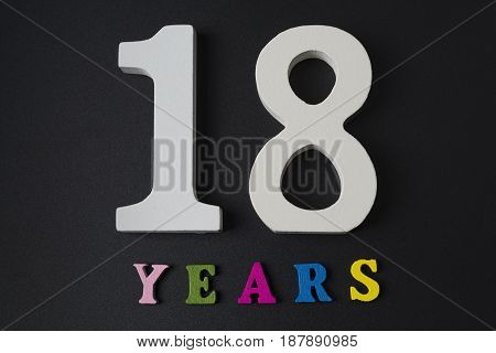 Letters And Numbers For Eighteen Years On A Black Background.