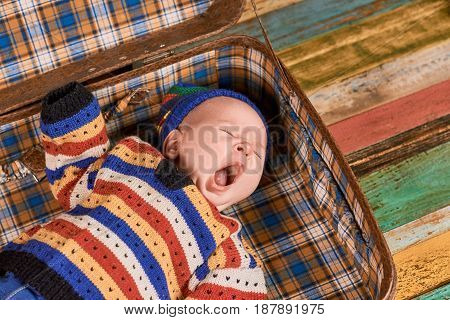 Cute baby yawning. Child lying with mouth open.