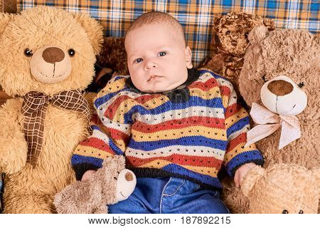 Baby and teddy bears. Infant boy with soft toys.