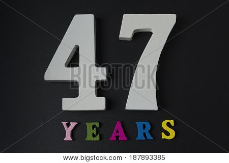 Letters And Numbers-forty-seven On A Black Background.