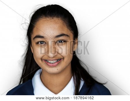 Portrait studio shoot of schoolgirl in uniform with smiling