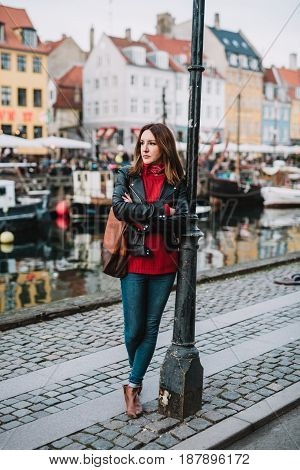 Woman standing in front of Nyhavn canal
