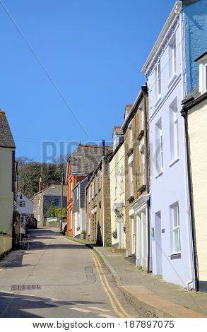 Picturesque English seaside village street on a bright sunny day with blue sky