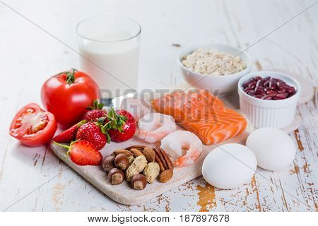 Food allergies - food concept with major allergens, rustic wood background