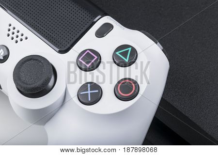 Sankt-Petersburg Russia May 20 2017: Sony PlayStation 4 game console with a joystick dualshock 4 on white background home video game console taken in Sankt-Petersburg on May 20 2017