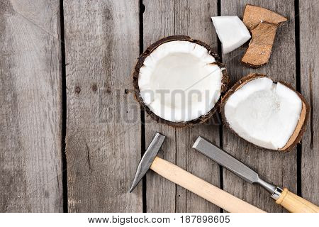 Pieces Of Fresh Tropical Coconut With Instruments On Wooden Background