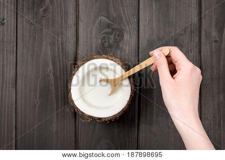 Human Hand Mixing Milk In Coconut With Wooden Spoon, Coconut Milk