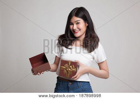 Young Asian Woman Open A Golden Gift Box.