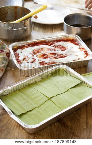 preparation green lasagne made with spinaches and and of the classic lasagne with bolognese ragu