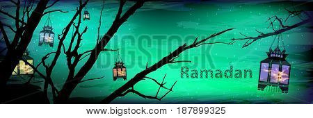 Ramadan. A lantern on a tree a lot. Light in the night sky. sunset. Green emerald background. Religion September Islam. Translation of the text from Arabic: Ramadan . Silhouette of flaming lights