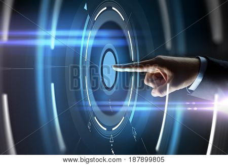 business, people and technology concept - close up of businessman hand pointing finger to virtual projection over black background