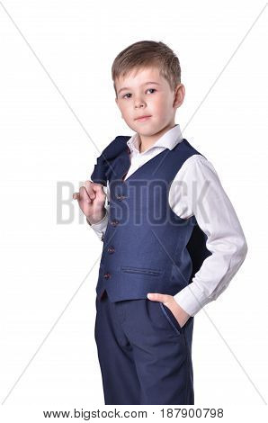 Schoolboy in blue suit with jacket on his sholder isolated on white background