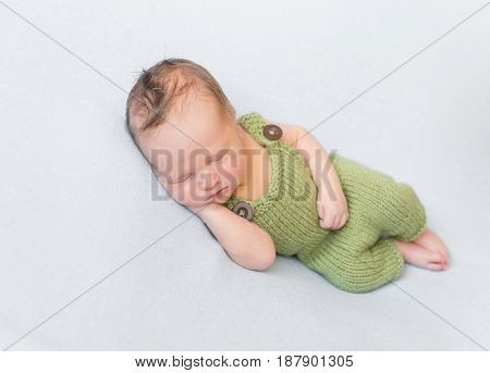 infant wearing summer green knitted costume