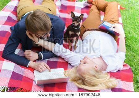 Young Attractive Couple Wearing Glasses Is Working Or Studying With Laptop Book Note And Pen Lying O