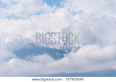 Ghostly Mountain Peak Showing From A Cloudy Veil