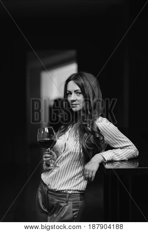 Portrait Of A Beautiful Woman With A Glass Of Wine In Her Hand